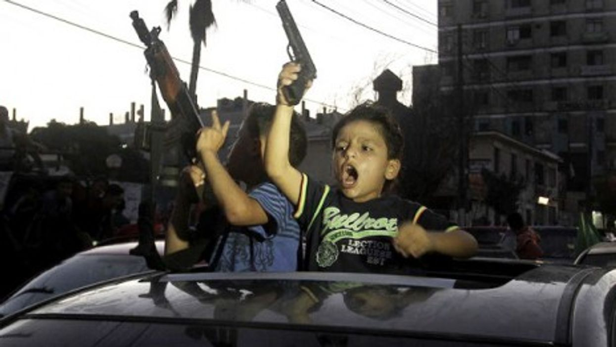 Children celebrating the open-ended ceasefire in Gaza.