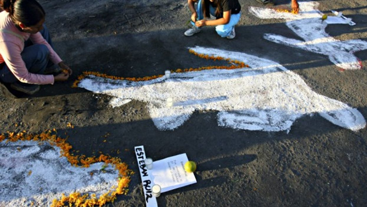 Children decorating chalk outlines in Oaxaca, Mexico