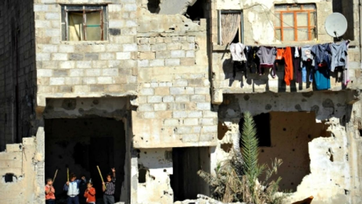 Children playing in Dukhaniyeh, in the suburbs of Damascus, Syria