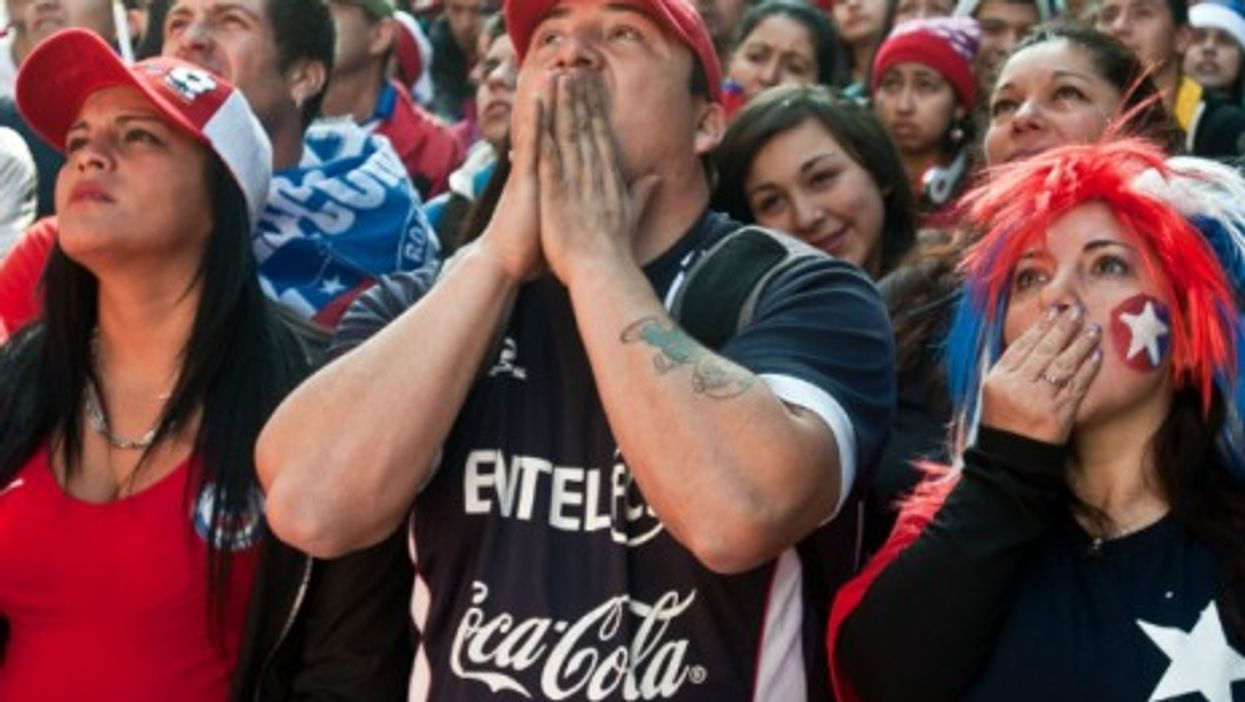 Chile's fans react to their team's defeat against Brazil