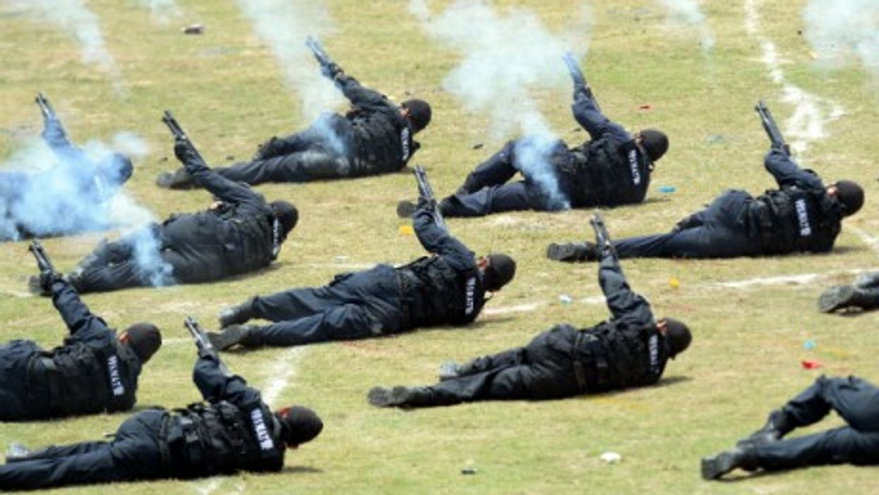 Chinese counter-terrorism forces perform an anti-terrorism drill in Beijing on May 29, 2014