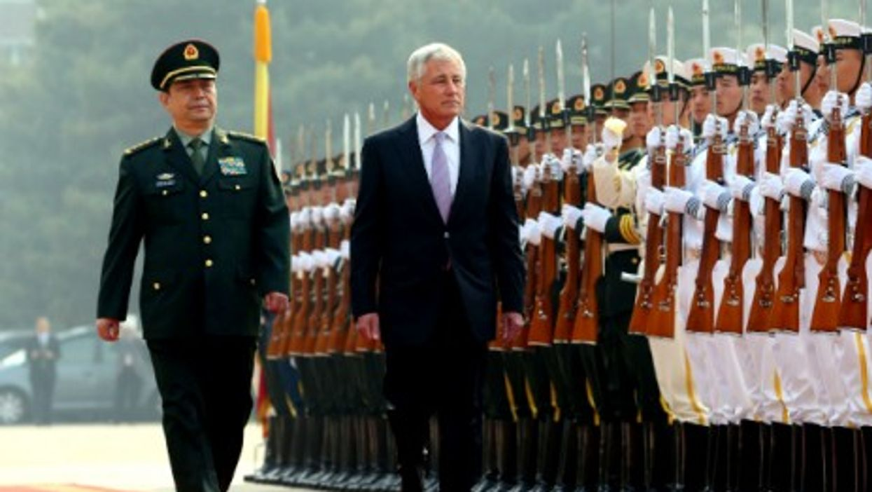 Chinese Defense Minister Chang Wanquan and U.S. Defense Secretary Chuck Hagel review the honor guard in Beijing