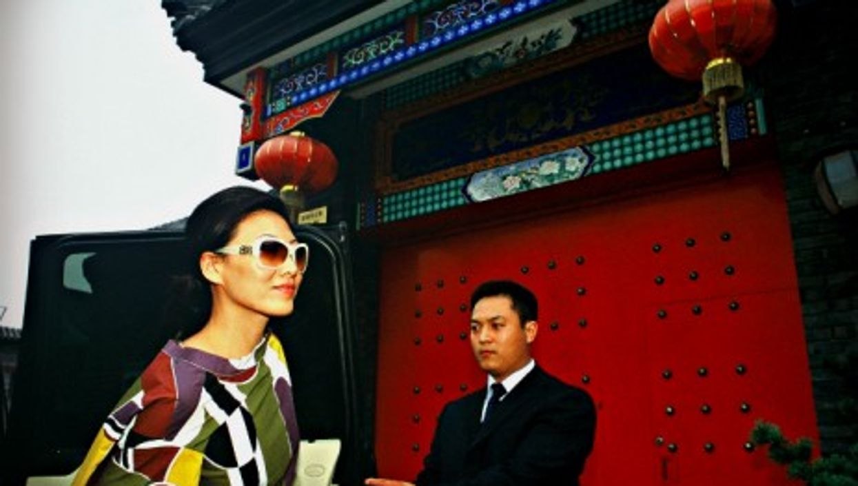 Chinese fashion shop owner Yuki Tan and her private chauffeur/bodyguard