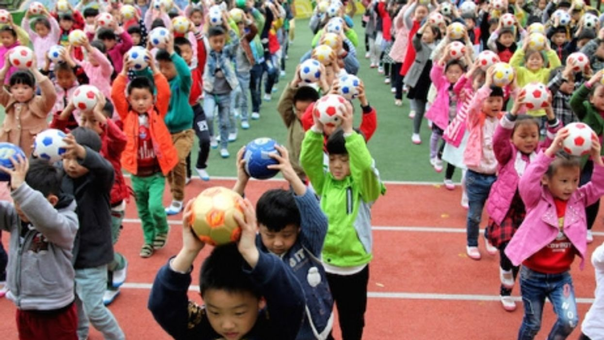 Chinese kindergartners practicing their soccer skills in Zaozhuang