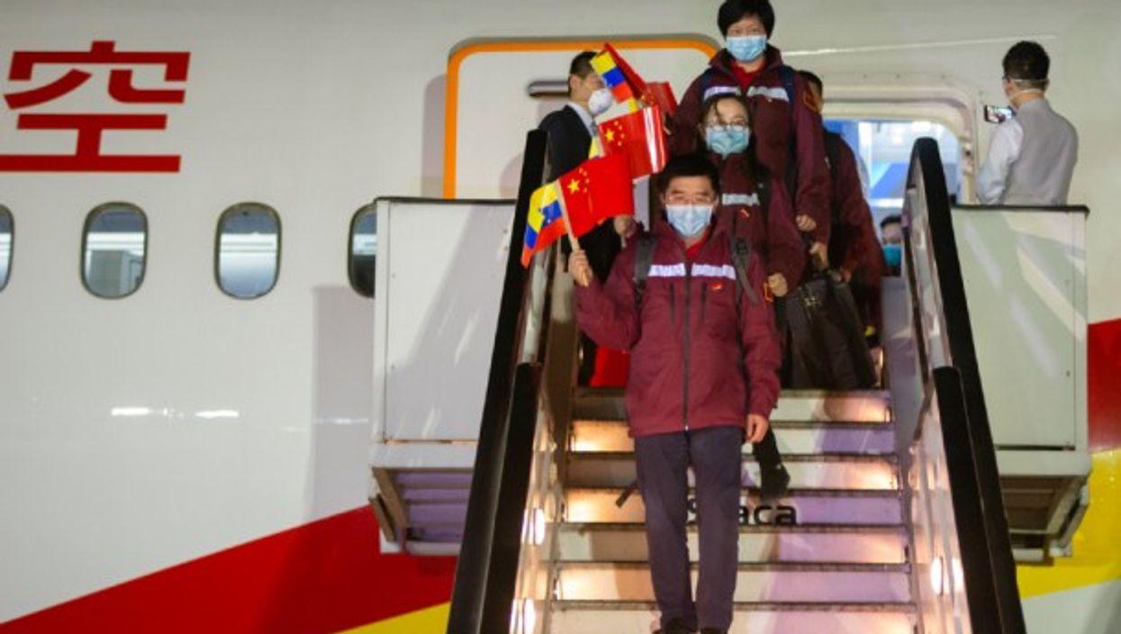 Chinese medical experts arrive in La Guaira, Venezuela, sent to help fight the coronavirus pandemic.