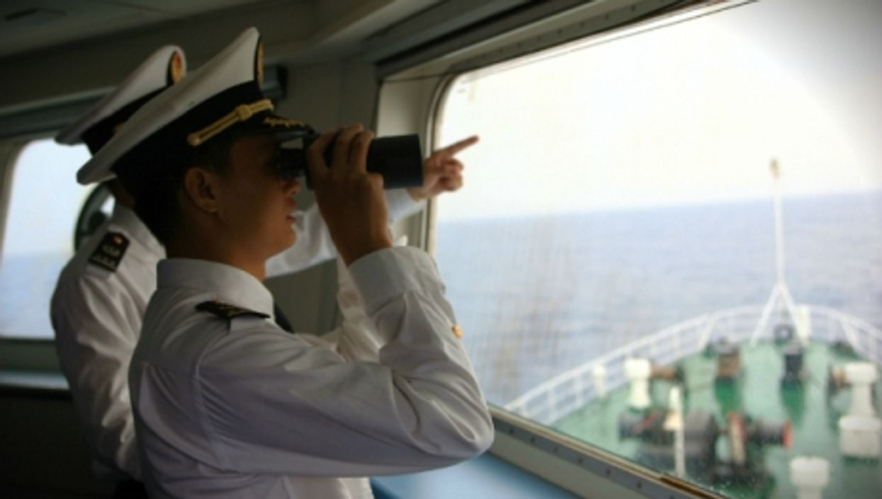Chinese officers monitor  the South China Sea