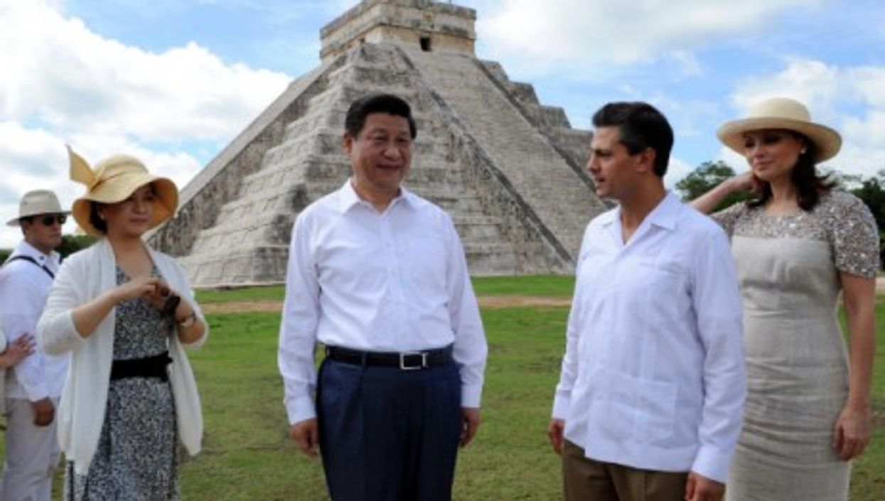 Chinese President Xi Jinping, accompanied by Mexican President Enrique Pena Nieto, visits Chichen Itza, an archaeological site of the Maya civilization in the Mexican state of Yucatan in June 2013