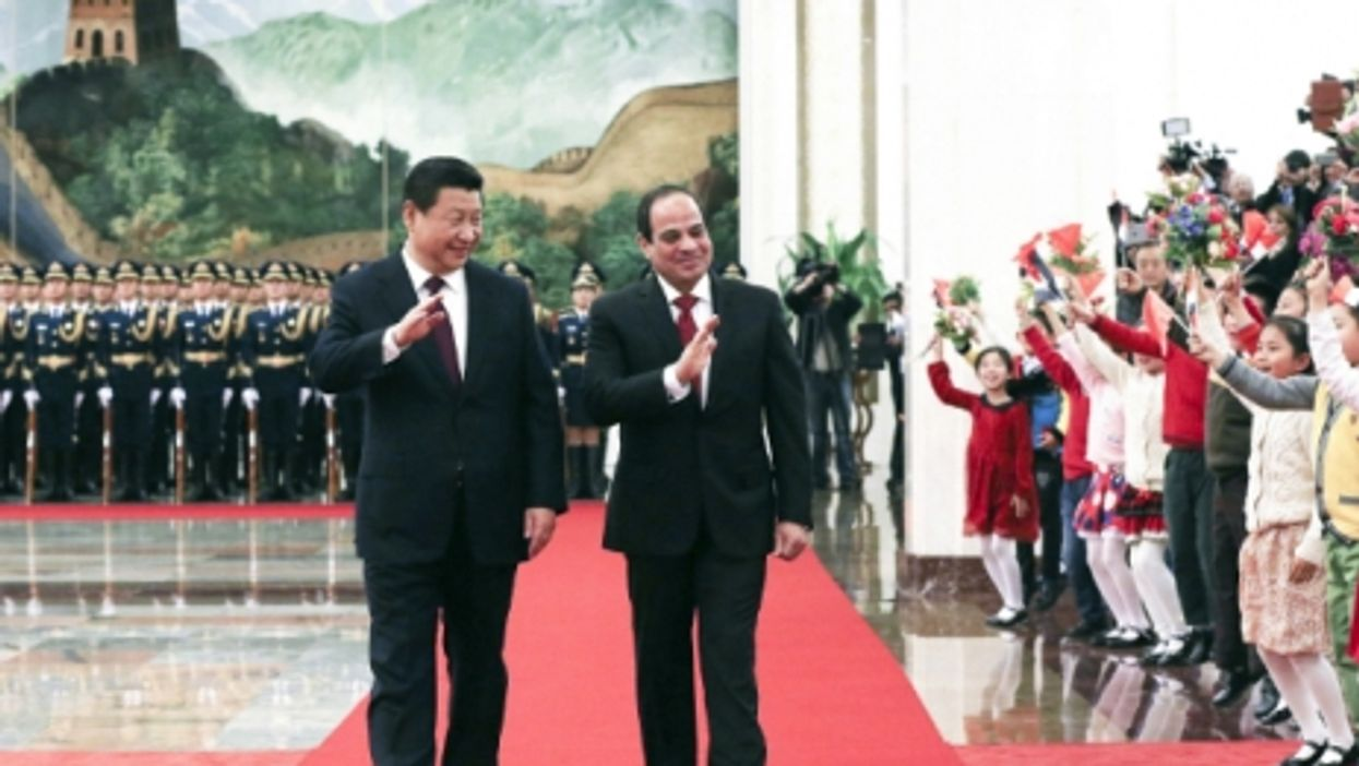 Chinese President Xi Jinping and Egyptian President Abdel Fattah al-Sisi wave to a crowd in Beijing