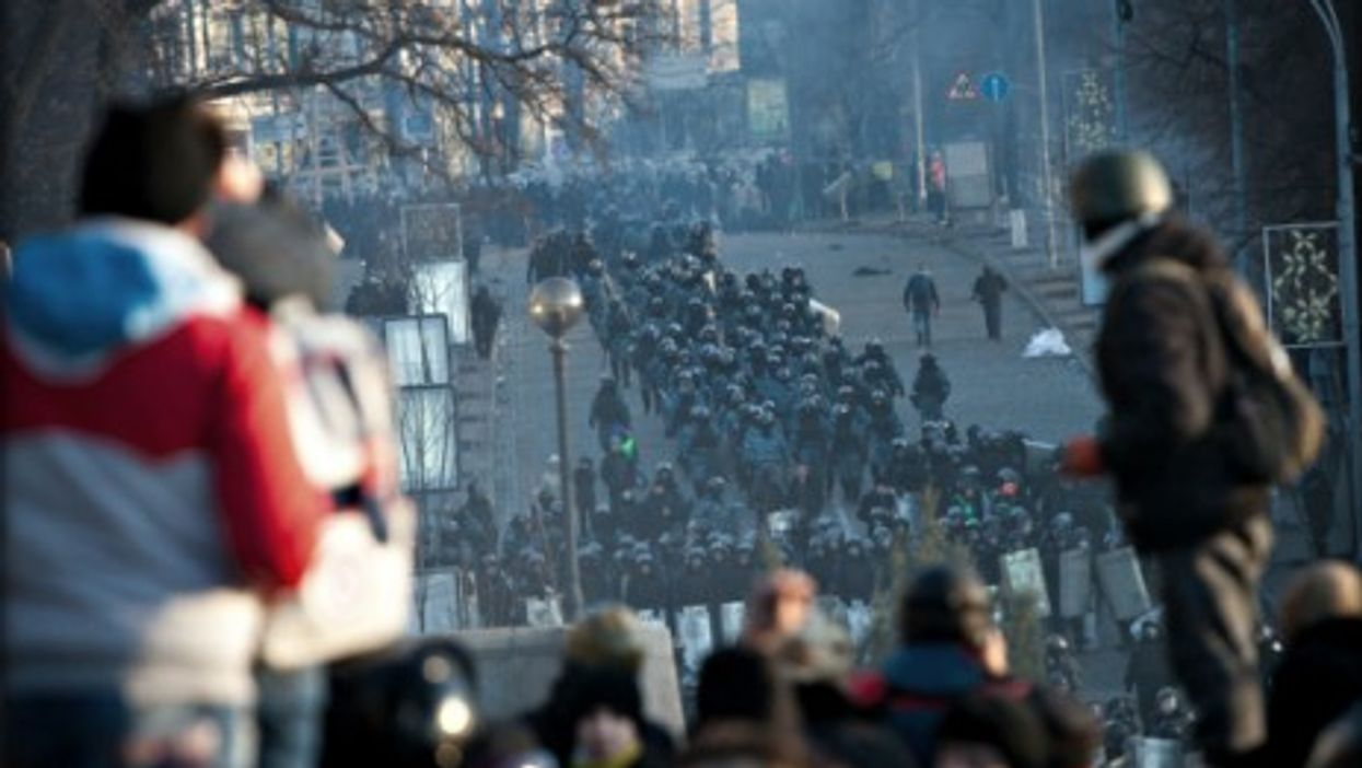 Clashes between anti-government protesters clash and riot police in Kiev on Feb. 18