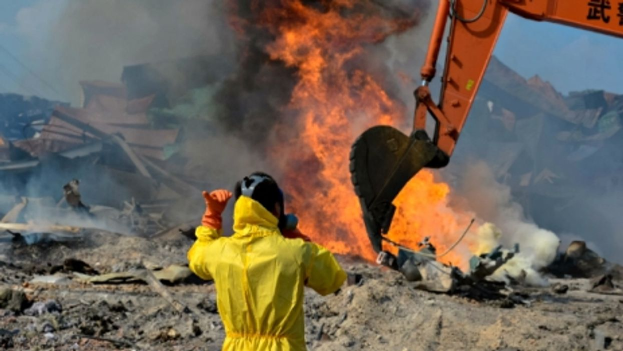 Cleaning up debris at the blast site in Tianjin on Aug. 23