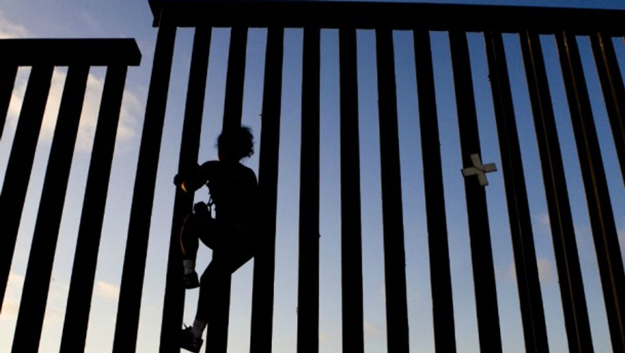Climbing the fence between U.S. and Mexico in Tijuana
