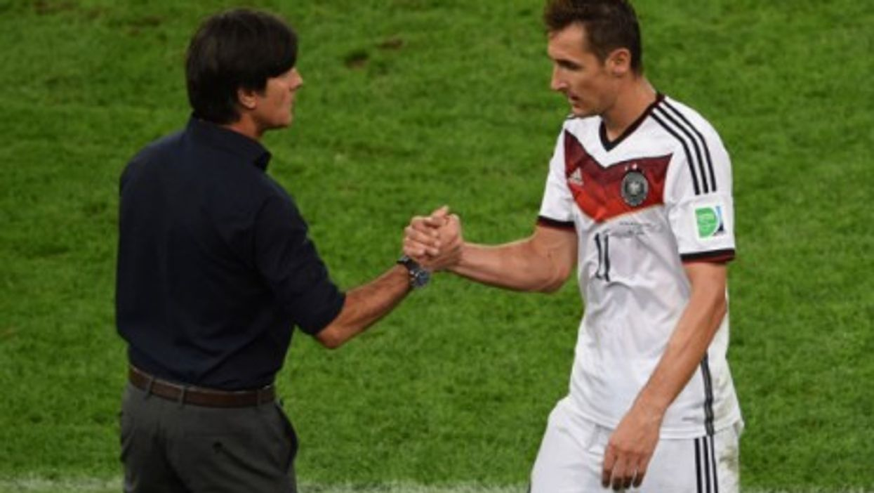 Coach Löw shakes hands with veteran Miroslav Klose during Sunday's match