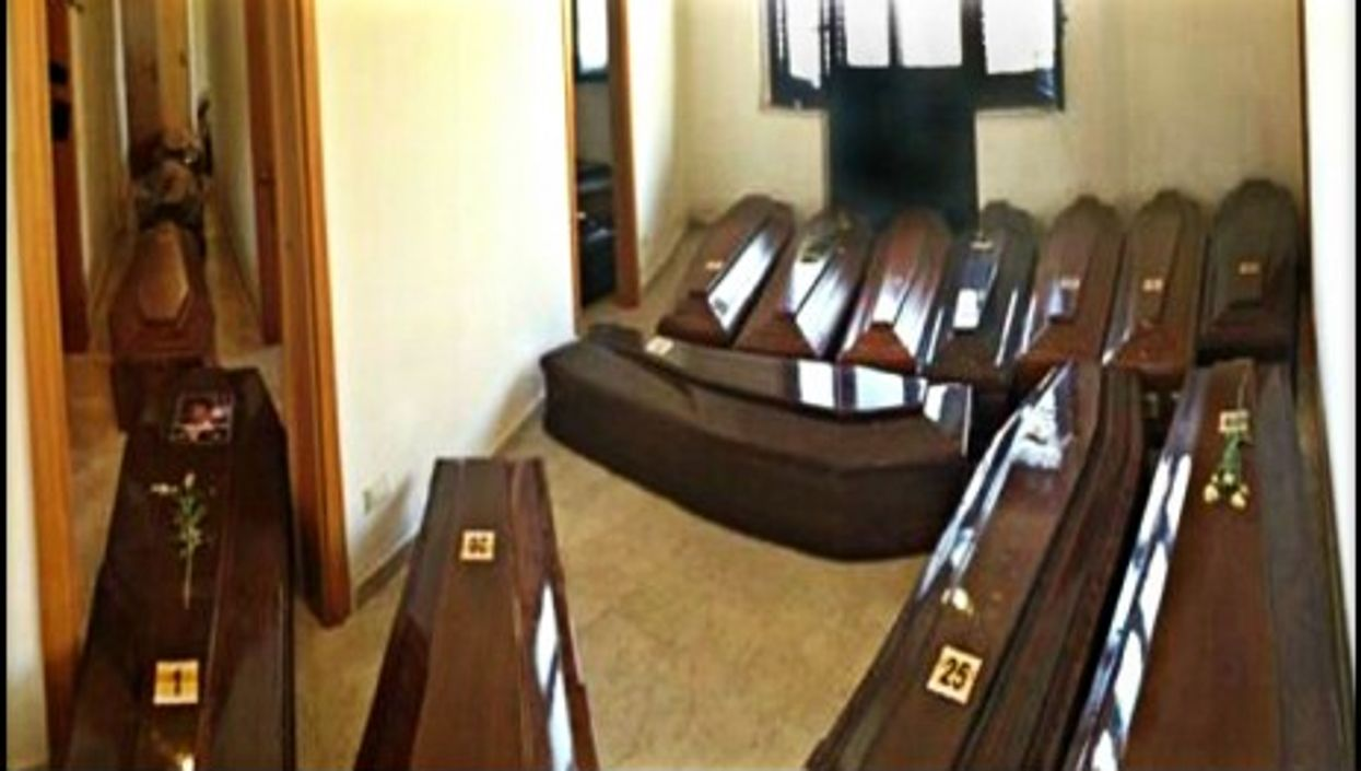 Coffins lined up side by side in Lampedusa