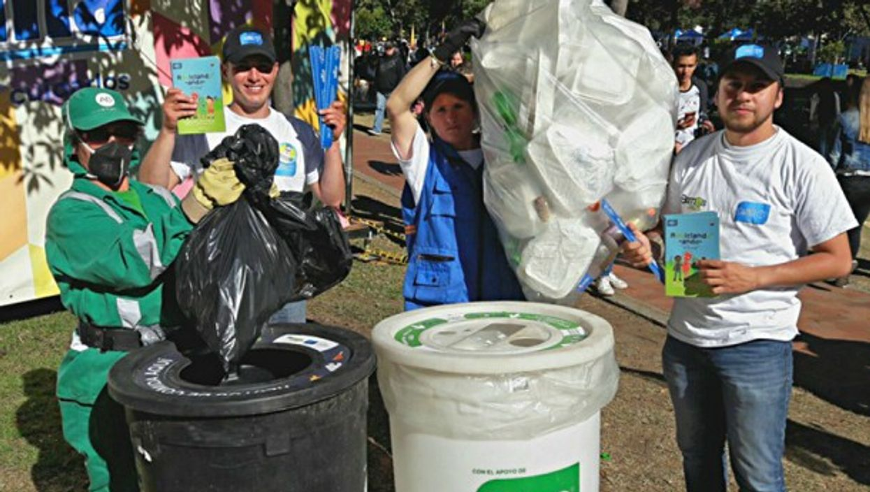Colombians separating the recyclables from non-recyclables at a Food Festival in Bogotá