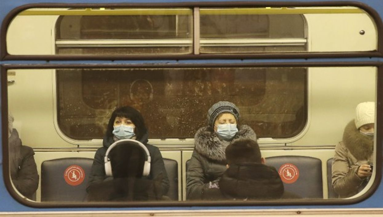 Commuters in face masks on a train in Russia