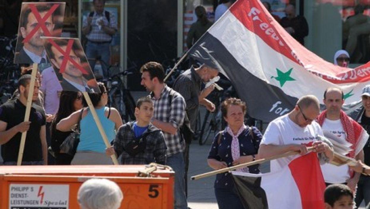 Critics of Syrian President Bashir al-Assadm protesting in Berlin