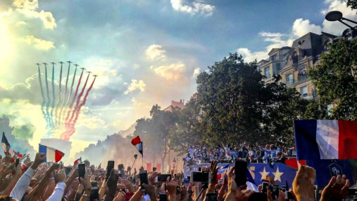 Crowd on the Champs-Elysées celebrating the new World Champions on July 16