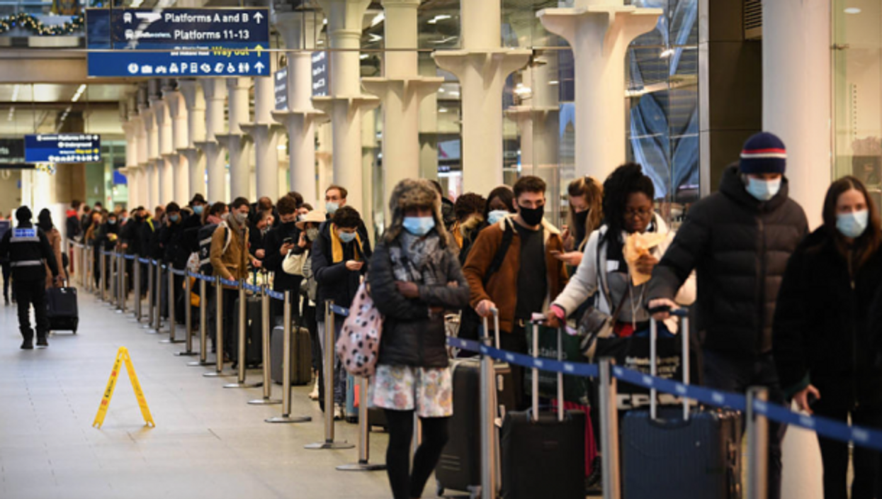 Crowds at London's St Pancras station after new lockdown measures were announced in the UK