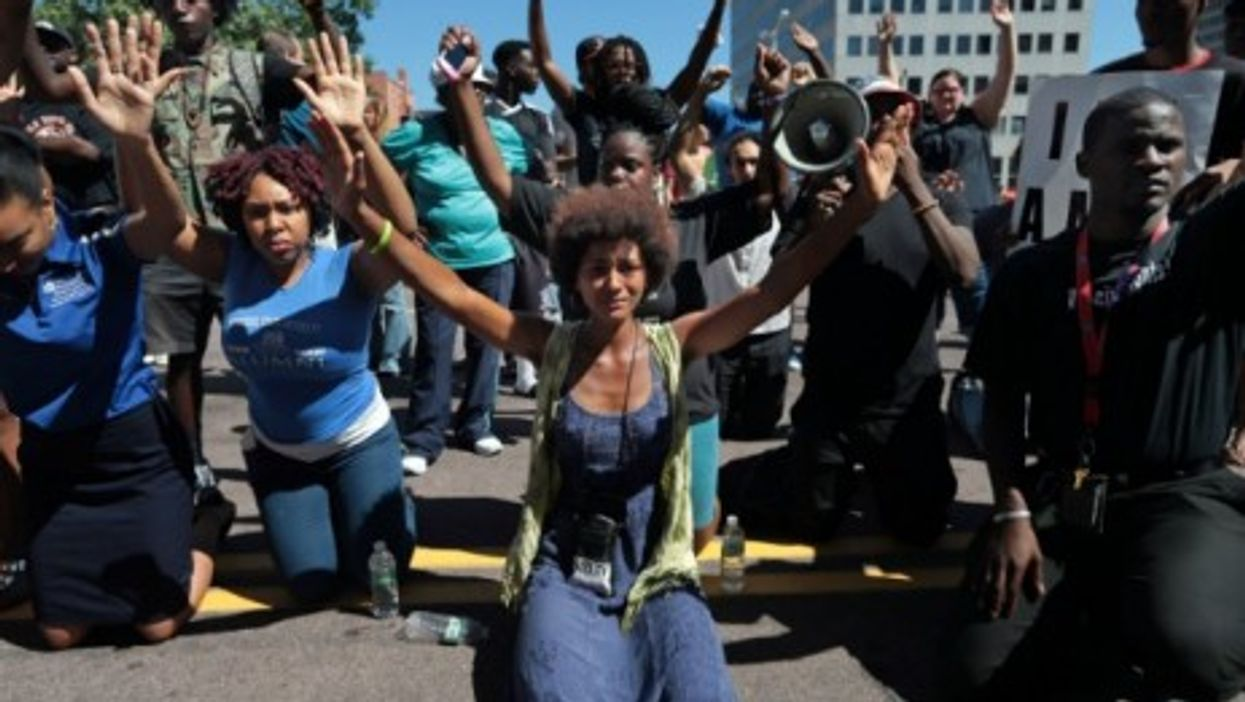 Crowds gathered Tuesday in Clayton, Missouri, to protest the fatal shooting of Michael Brown by a police officer in Ferguson Saturday.