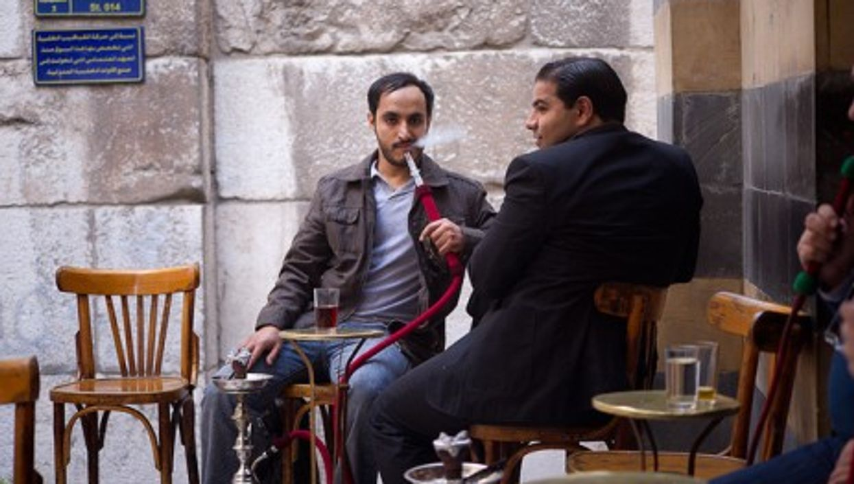 Customers in a Damascus café. Waiters are known to collect information overheard from clients.