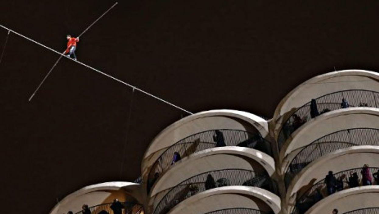 Daredevil Nik Wallenda walking a tightrope Sunday in Chicago