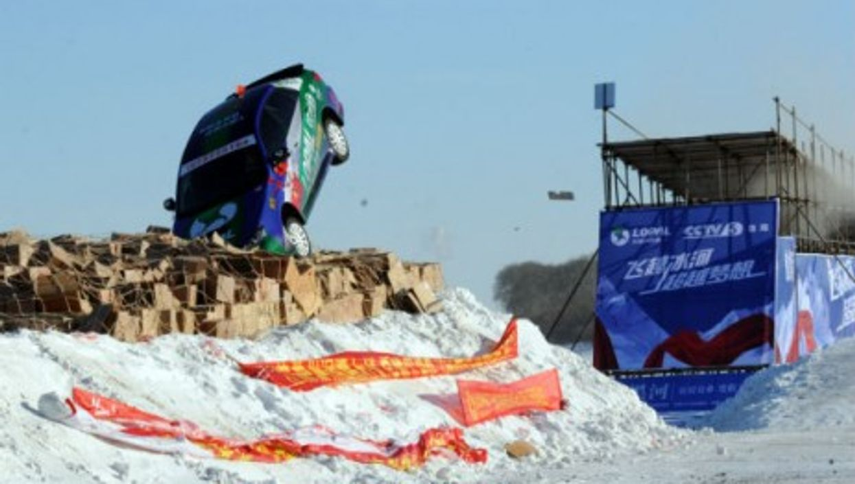Daredevil Xie Yujun leaps over the frozen Heilongjiang River in a stunt car in Heihe, in China