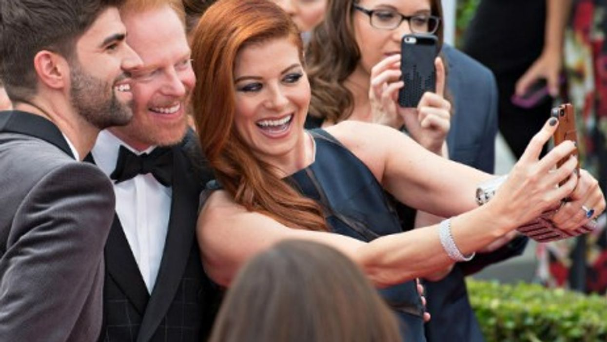 Debra Messing, Jesse Tyle and Justin Makita's snap selfie at the 2014 Emmy Awards