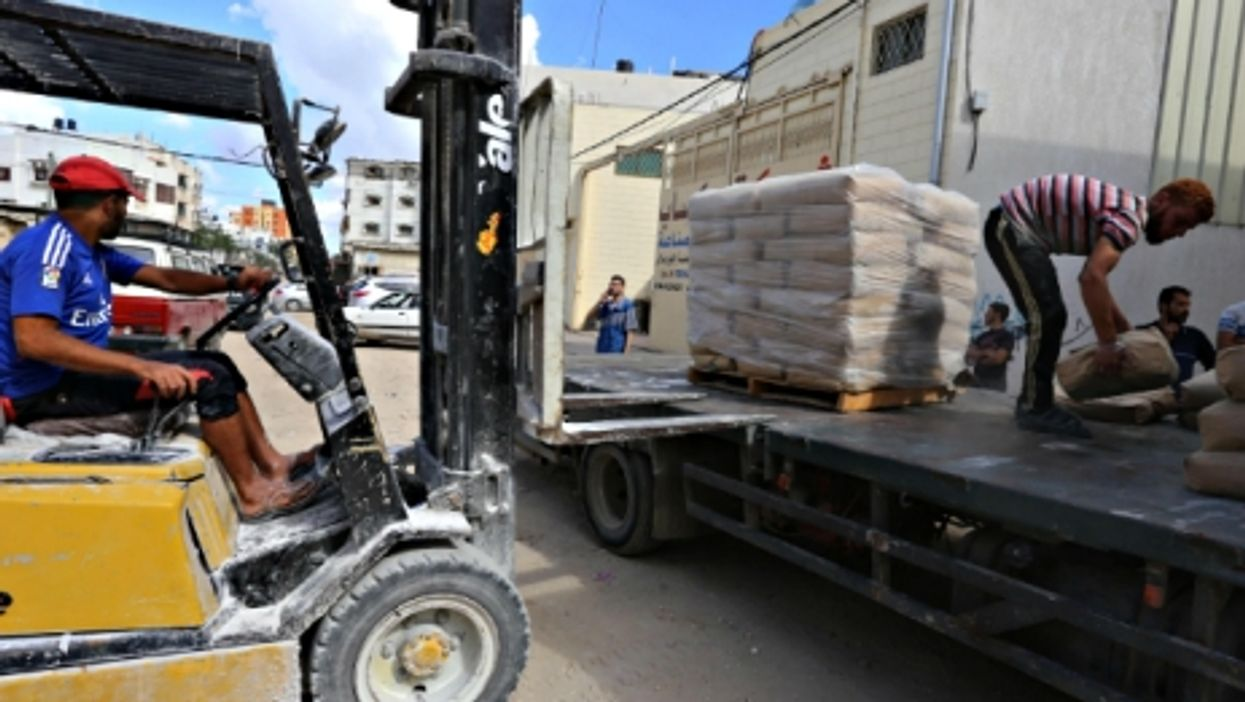 Delivering bags of cement in the east of Gaza