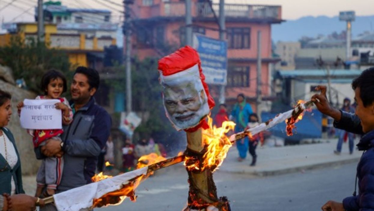 Demonstrators burns an effigy of Indian Prime Minister Narendra Modi during a protest against the encroachment of Nepal border by India.