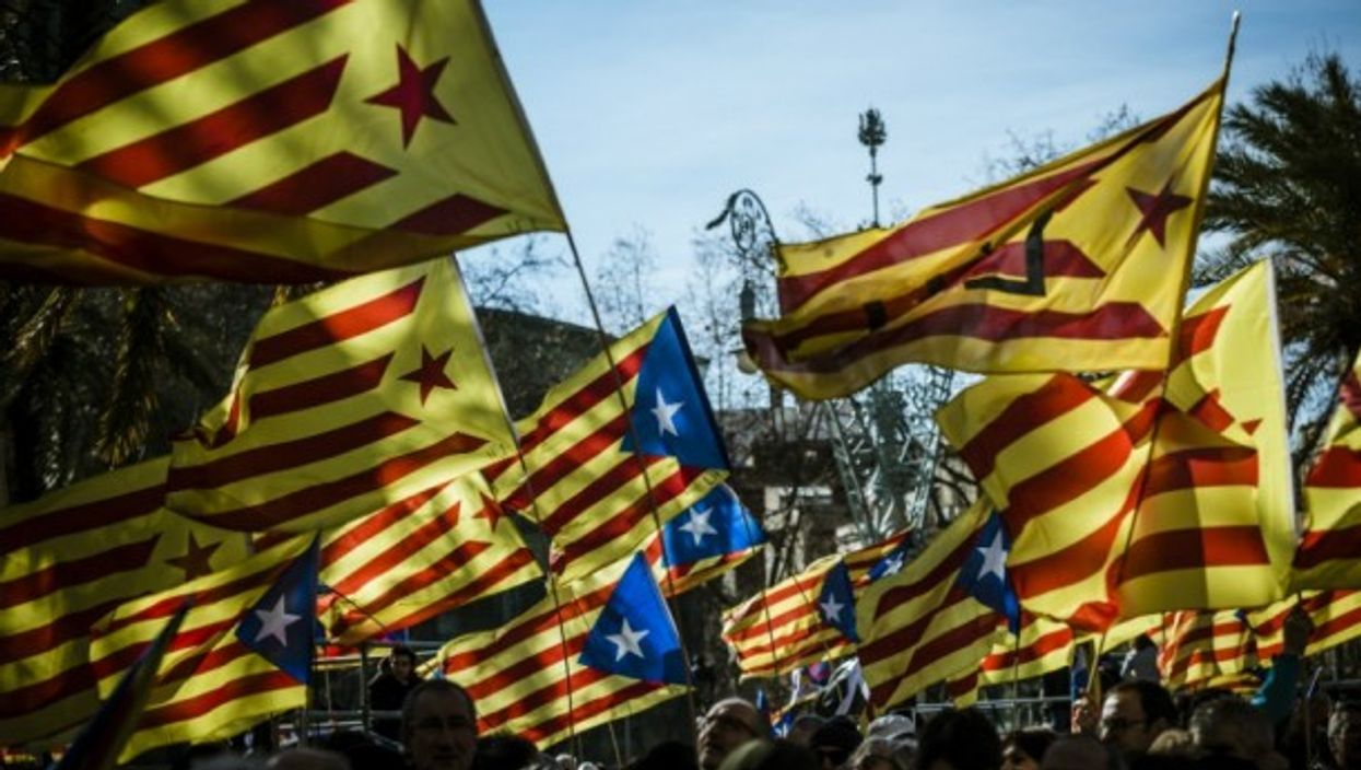 Demonstrators fly the Estelada, the unofficial flag of independent Catalonia, in February.