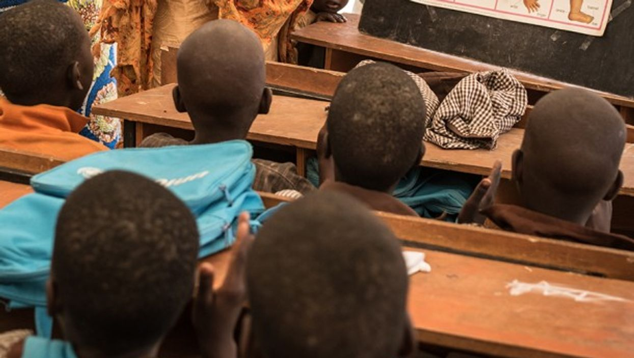 Detail of a classroom photograph in a displaced persons camp in Nigeria.