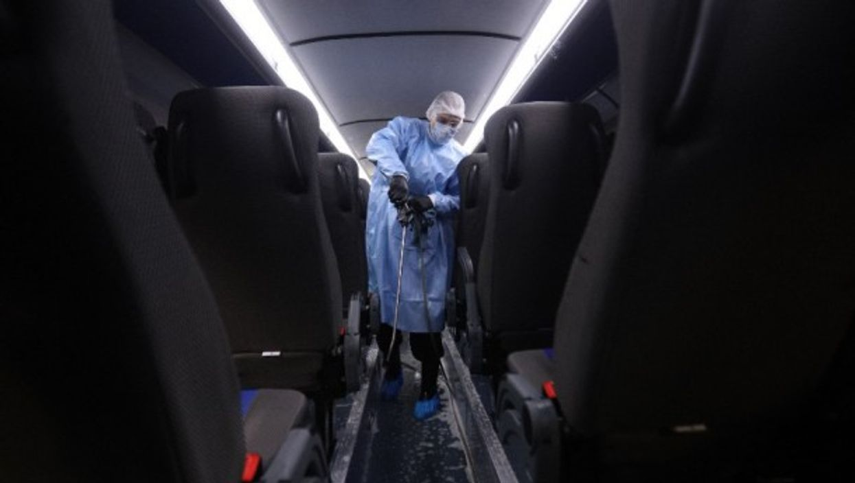 Disinfecting a bus in St. Petersburg, Russia