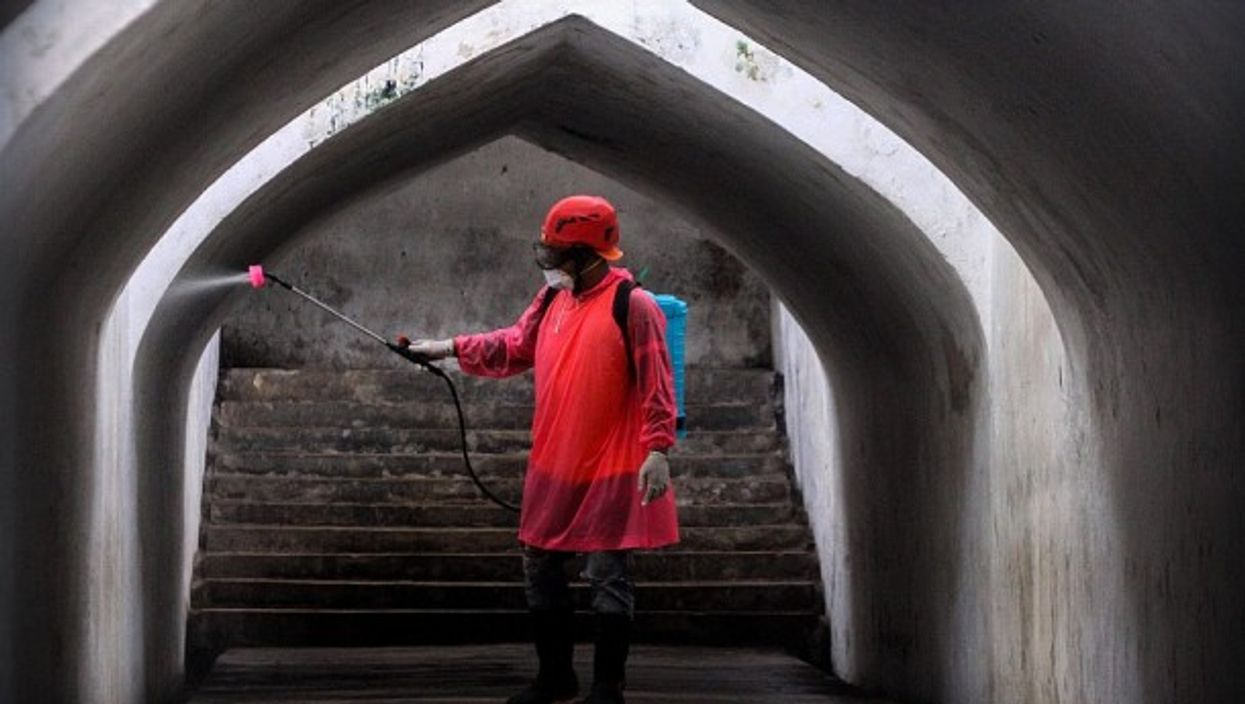 Disinfecting an Indonesian underpass last March
