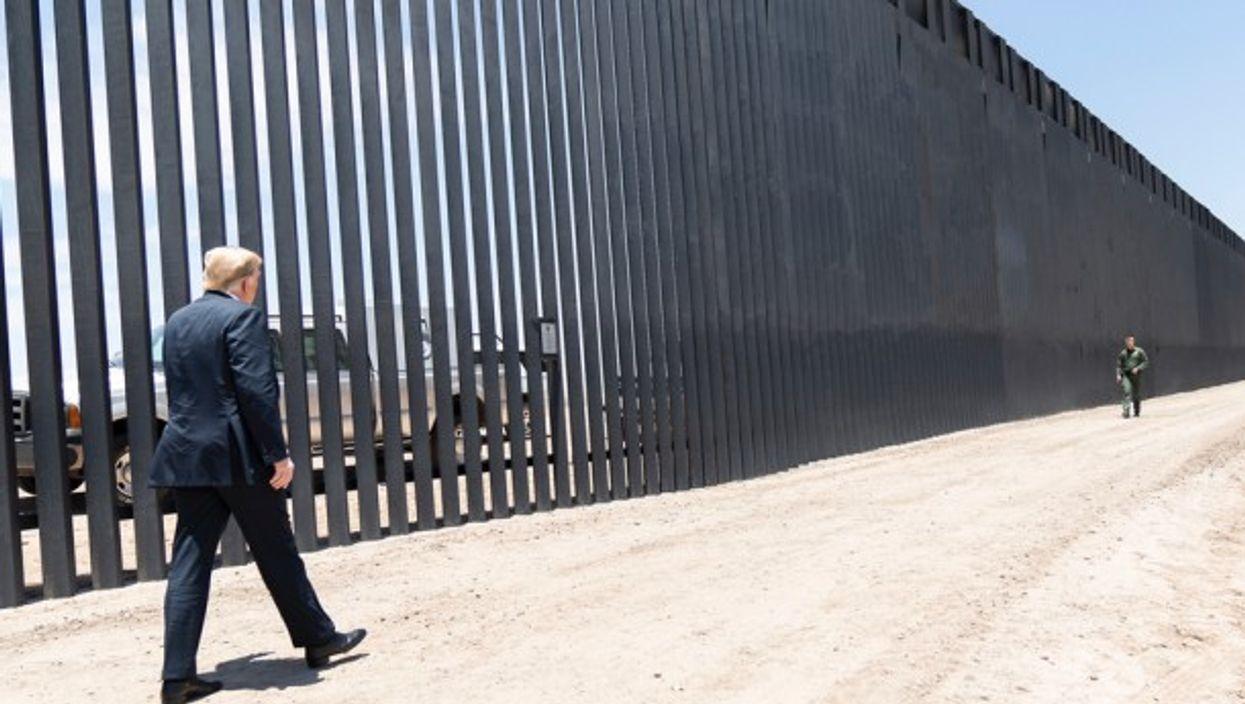 Donald Trump walking along the Mexican-American border