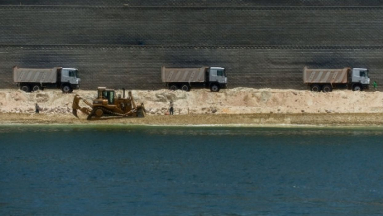 Dredging the extension of the Suez Canal.
