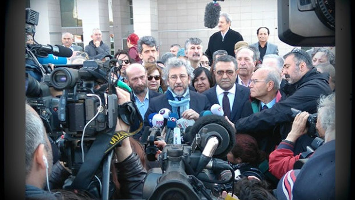 Dundar, center, after his release from jail.