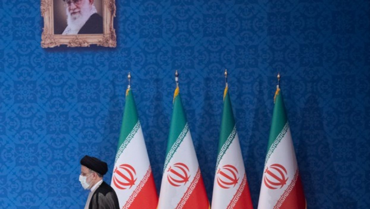 Ebrahim Raisi arrives at his first press conference as Iran's newly elected president, in Tehran.
