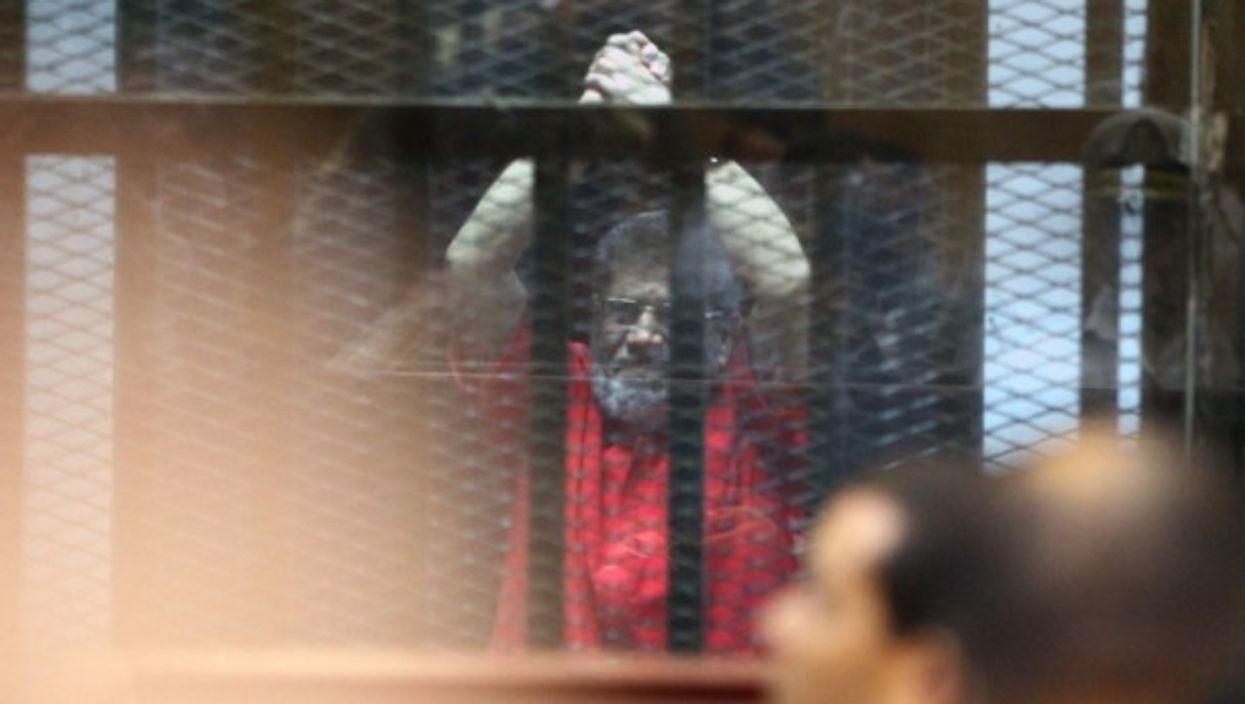 Egypt's Former President Mohamed Morsi in a court in Cairo on June 18.