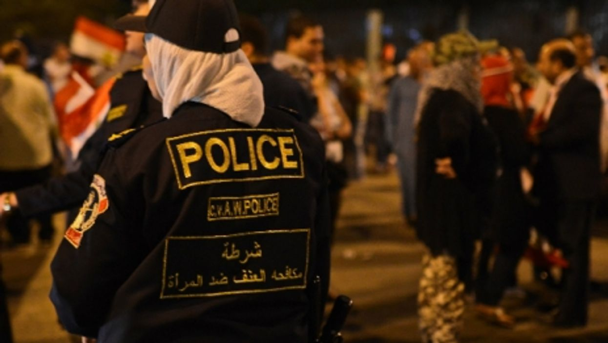 Egyptian Policewomen stand guard during a rally in Cairo