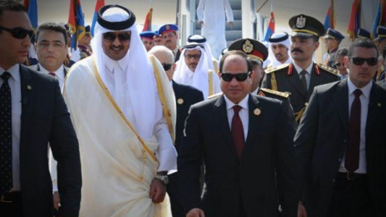 Egypti's al Sisi (R) receives Qatar Sheikh al Thani upon his arrival ahead of the Arab League Summit in Sharm el-Sheikh.