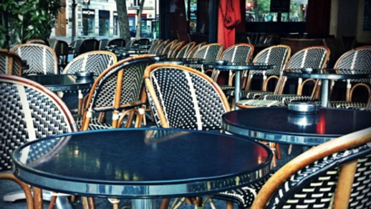Empty seats on a Parisian cafe terrace