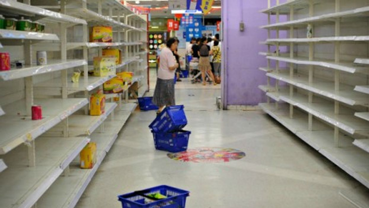 Empty shelves in a Tesco store in Changning, China