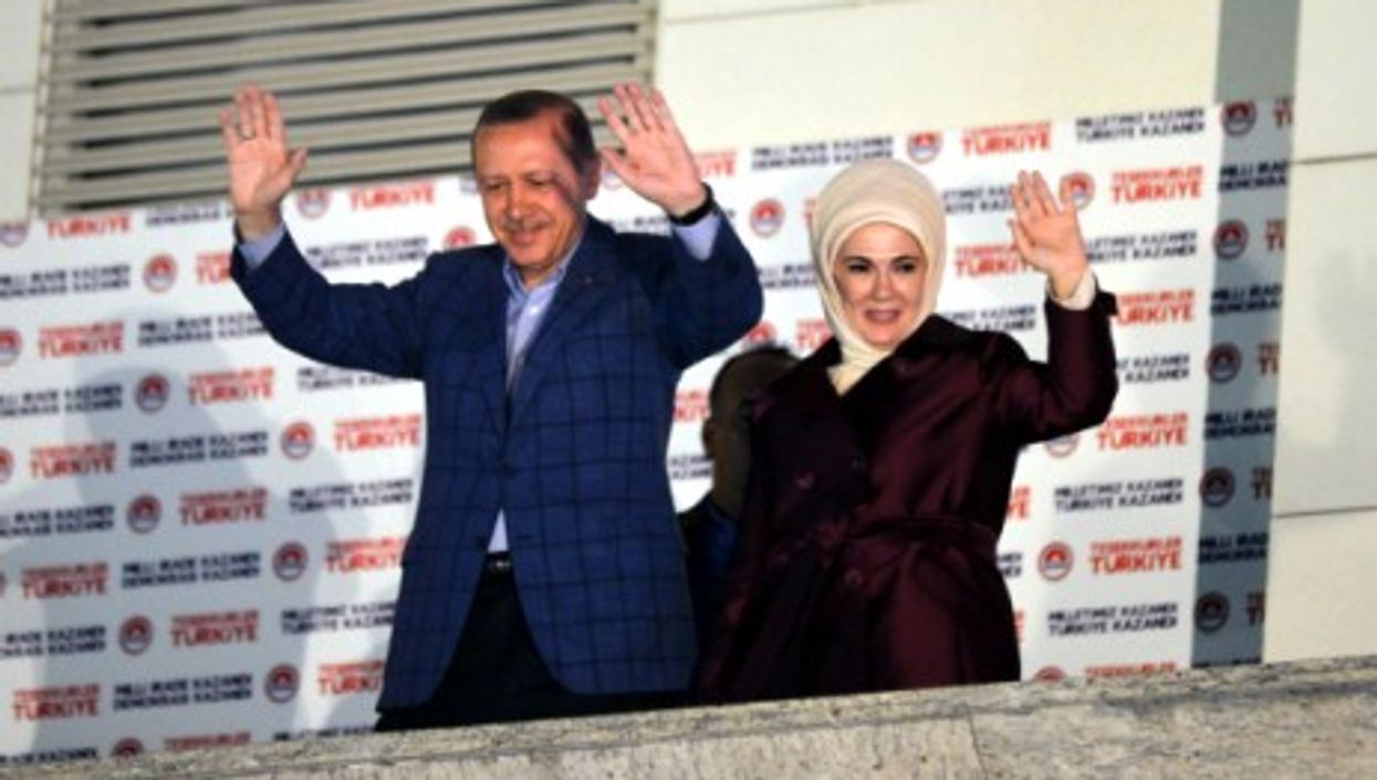 Erdogan and his wife during the celebration of his presidential victory, on Aug. 10.