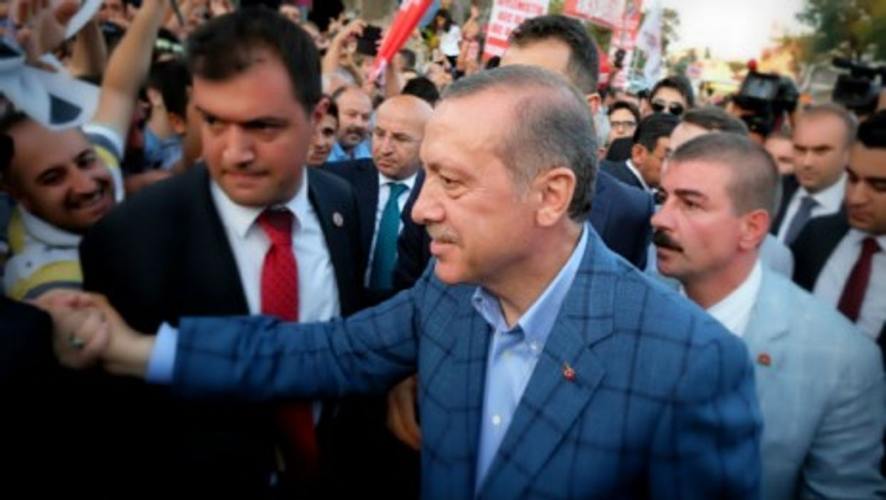 Erdogan saluting supporters in Istanbul late Sunday