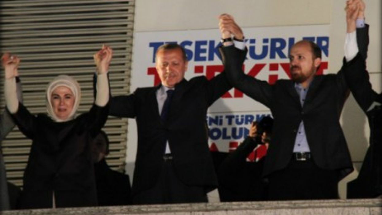 Erdogan (second from left) celebrates victory with his ruling party in the local elections