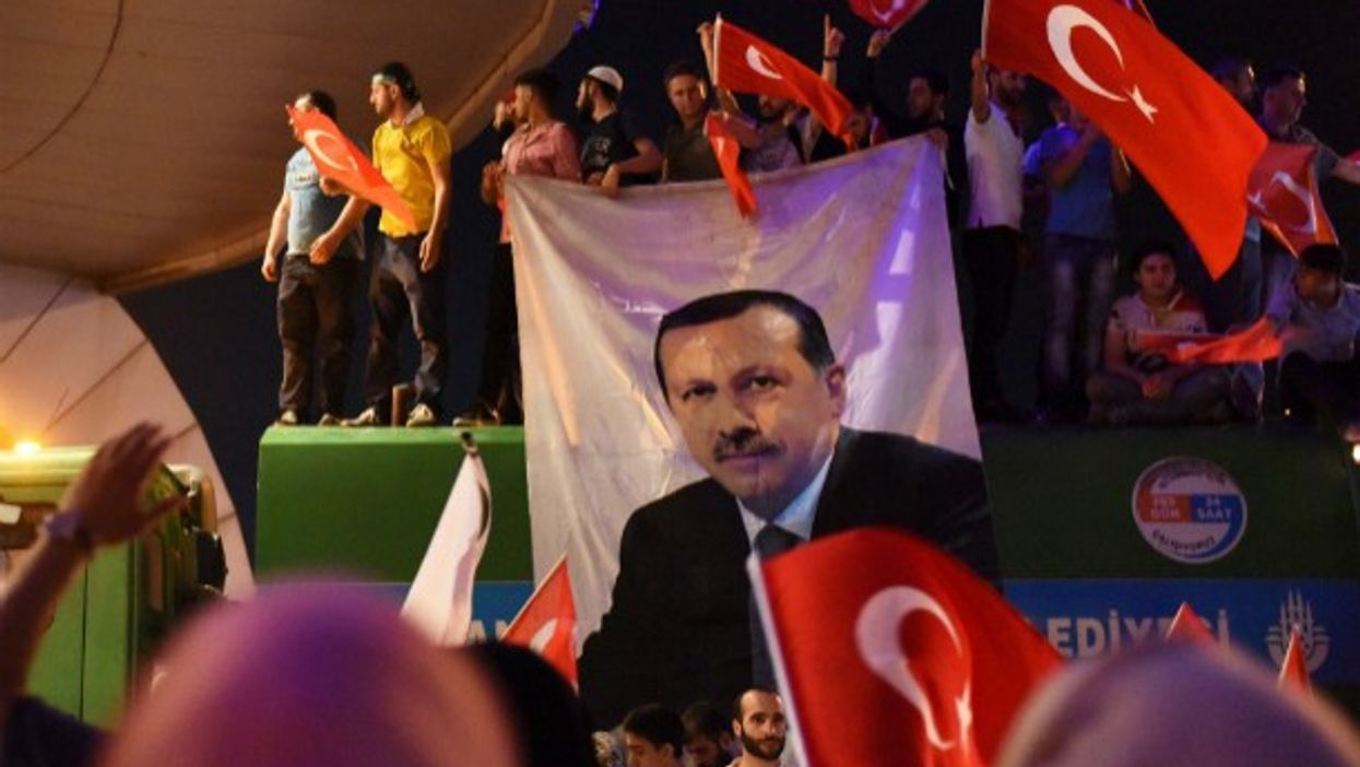 Erdogan's supporters carry his image