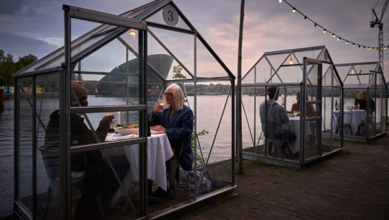 Eten Restaurant, part of the Mediamatic Biotoop centre in Amsterdam, has tested greenhouse-like booths for customers to eat in.