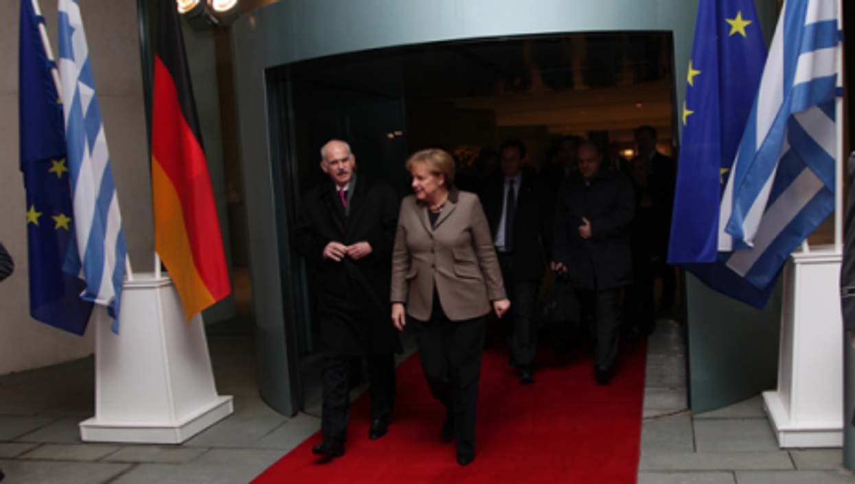 Exit Papandreou, shown last year with German Chancellor Merkel