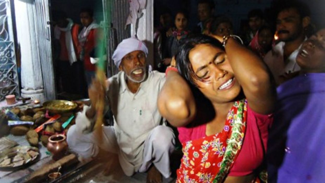 Exorcist at work duing the Malajpur ghost fair