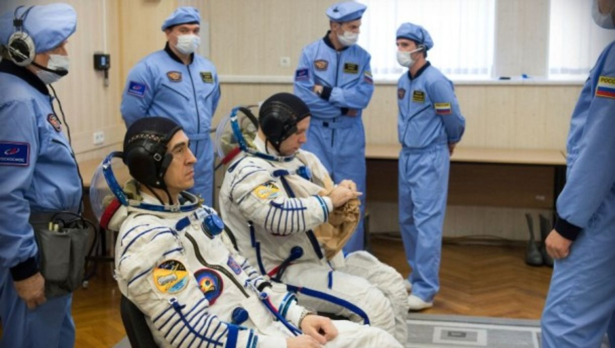 Expedition 63 crewmembers Ivanishin and Vagner prepare to go the ISS